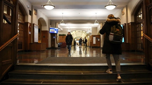 Students enter the University of Michigan Union on Tuesday, Dec. 5, 2017. The Union is closing in the spring and is expected to stay closed for 20 months as part of an $85.2 million renovation project.   (Hunter Dyke/The Ann Arbor News via AP)