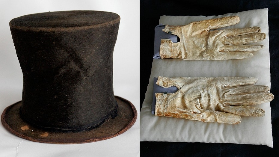 Abraham Lincoln's iconic stovepipe hat and the bloodstained gloves he carried on the night of his death might be sold off if the foundation that purchased them can't pay off a decade-old loan that financed items related to the 16th president.