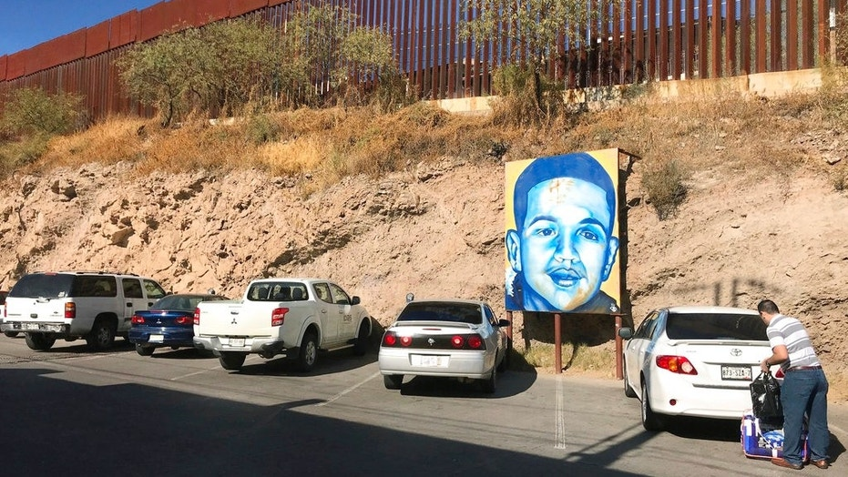 A portrait of Mexican teenager Jose Antonio Elena Rodriguez, who was mortally wounded in 2012, is seen on the street in December 2017, where he died.