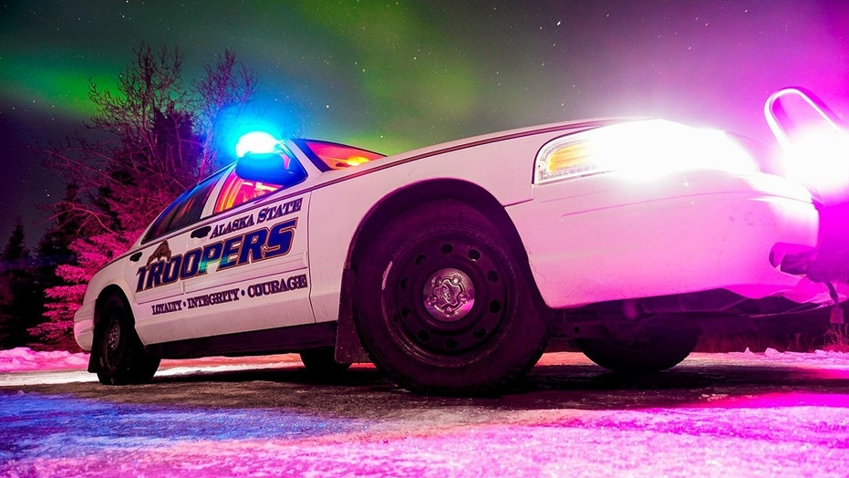 Alaska State Troopers apprehended a man accused of stabbing two people outside a rural school.