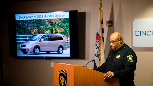 FILE - In this April 12, 2018, file photo, Cincinnati Police Chief Eliot Isaac speaks to reporters about the death of Kyle Plush during a news conference at the Criminal Investigation Section conference room, in Cincinnati. Cincinnati officials expect to review a plan for improving the city's emergency center while police finish an internal investigation into the death of Kyle Plush who twice called 911 to report he was trapped in a minivan. Cincinnati police say Isaac will release results Wednesday, May 2, of their probe into what went wrong in efforts to locate the teenager. (Meg Vogel/The Cincinnati Enquirer via AP, File)