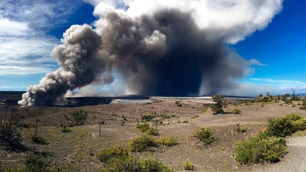 This photo from the U.S. Geological Survey shows activity at Halema'uma'u Crater that has increased to include the nearly continuous emission of ash with intermittent stronger pulses at Hawaii Volcanoes National Park on the island of Hawaii at around 9 a.m. Tuesday, May 15, 2018. Plumes range from 1 to 2 kilometers (3,000 to 6,000 feet) above the ground. Officials on the Big Island of Hawaii say some vents formed by Kilauea volcano are releasing such high levels of sulfur dioxide that the gas poses an immediate danger to anyone nearby. (U.S. Geological Survey via AP)