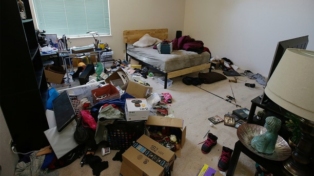 Toys and other items are strewn around one of the bedrooms of a home in Fairfield, Calif., Monday, May 14, 2018, where authorities removed 10 children and charged their father with torture and their mother with neglect after an investigation revealed a lengthy period of severe physical and emotional abuse. (AP Photo/Rich Pedroncelli)