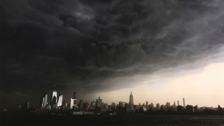 Storm clouds seen gathering over New York City on Tuesday. The National Weather Service on Wednesday said two tornadoes hit Putnam County, New York amid storms across the Northeast.