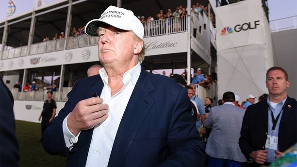 Mar 6, 2016; Miami, FL, USA; Republican presidential hopeful Donald Trump walks onto the 18th green for the awards ceremony following the final round at TPC Blue Monster at Trump National Doral. Mandatory Credit: John David Mercer-USA TODAY Sports  / Reuters 