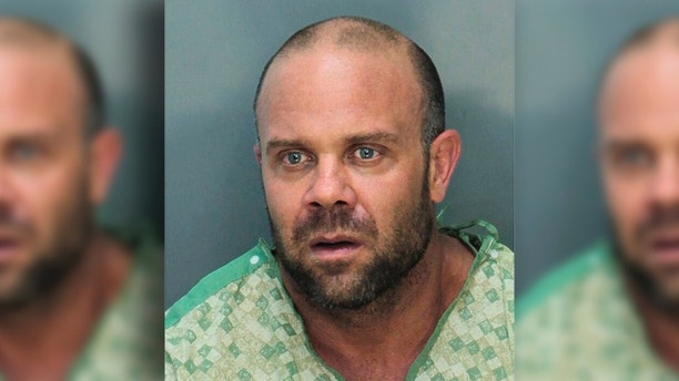 This May 2018 photo provided by the Miami Dade Department of Corrections shows Jonathan Oddi. Police say Oddi stormed the lobby of the Trump National Doral Golf Club early Friday, May 18, carrying an American flag and shouting about the president. According to police, he fired at a chandelier before exchanging gunfire with officers, who shot him in the legs and took him into custody. (Miami Dade Department of Corrections via AP)