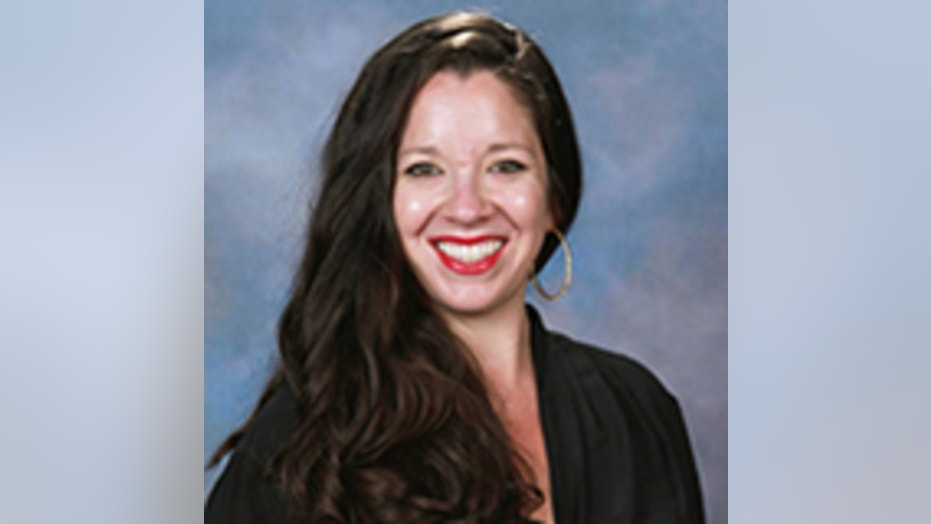 Alix Morales, a Spanish teacher at Siegel High School, was suspended without pay after being accused of selling alcohol to students.