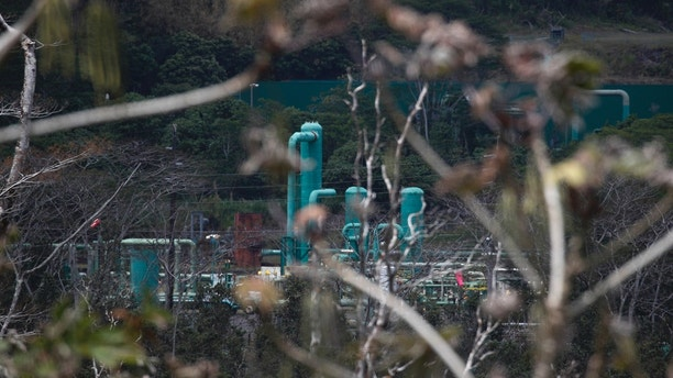 A a geothermal plant is seen from the Leilani Estates subdivision near Pahoa, Hawaii, Tuesday, May 22, 2018. Authorities were racing Tuesday to close off production wells at the plant threatened by a lava flow from Kilauea volcano on Hawaii's Big Island. (AP Photo/Jae C. Hong)