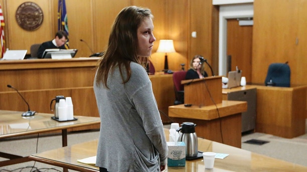 FILE - In this May 16, 2018, file photo, Emily Glass appears in Sedgwick County District Court in Wichita, Kan. Glass, the stepmother of a 5-year-old Wichita boy who has been missing since February, was found not guilty Wednesday of child endangerment in an unrelated case involving her own daughter. Glass was booked into jail Thursday evening, May 24, 2018, on suspicion of interfering with a law enforcement officer and obstruction after a body was found under a bridge on a gravel road in Harvey County. Authorities have not released any information on the remains. (Travis Heying/The Wichita Eagle via AP, File)