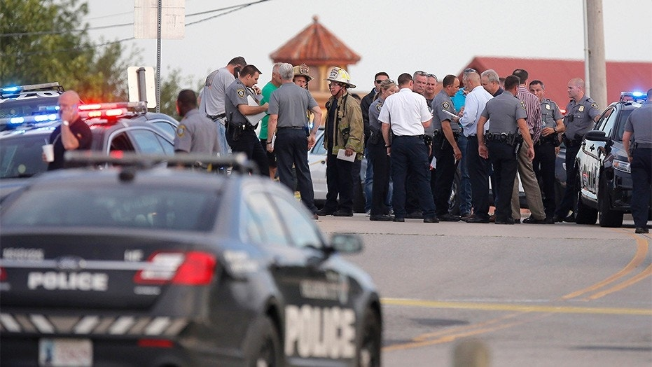 May 24, 2018: Police and emergency personnel surround the scene of the shooting at Lake Hefner in Oklahoma City.