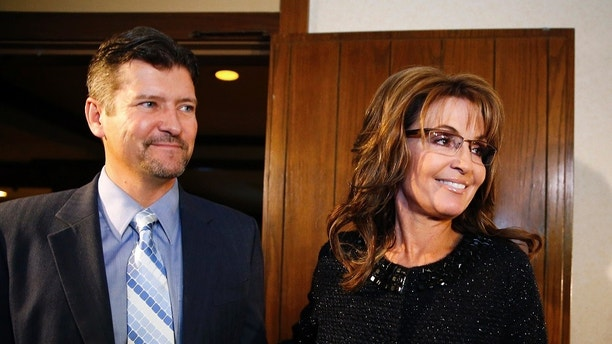 Former Republican governor of Alaska Sarah Palin and her husband Todd arrive for a celebration for evangelist Billy Graham's 95th birthday in Asheville, North Carolina November 7, 2013. REUTERS/Chris Keane (UNITED STATES - Tags: POLITICS RELIGION ENTERTAINMENT) - GM1E9B80N7W01