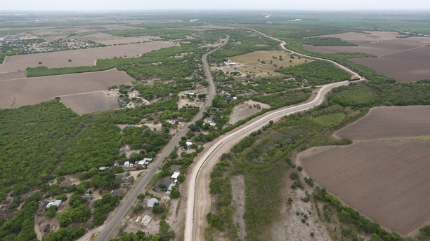 A levee, which acts as a border wall, is pictured in the Rio Grande Valley sector, near McAllen, Texas, U.S., April 4, 2018.  REUTERS/Loren Elliott - RC1E5FACBF00