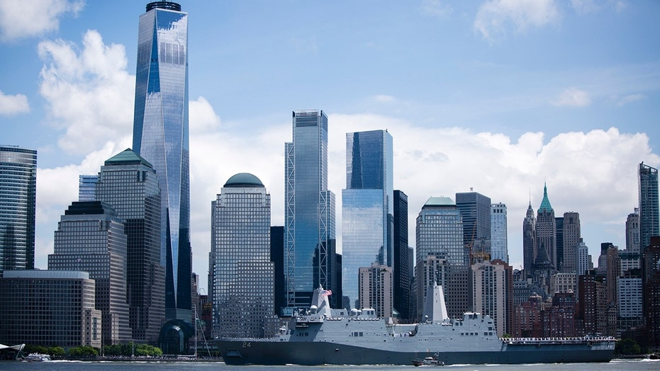 May 23, 2018: The USS Arlington, an amphibious transport dock ship named in tribute to the victims of the attack on the Pentagon on 9/11, sails past the World Trade Center as part of New York City's 2018 Fleet Week.