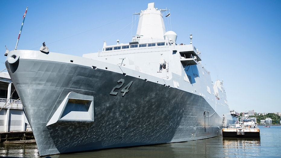 The USS Arlington currently is docked on Pier 90 in Manhattan's west side, near the Intrepid Sea, Air & Space Museum.