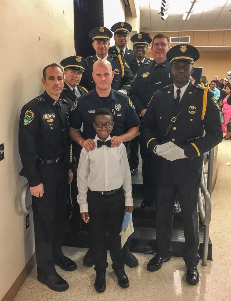 Police officers attend boy's 5th grade graduation in place of fallen father