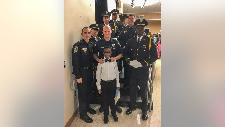 Nine of the Joe Crowder's former colleagues attended his son's 5th grade graduation on Friday.