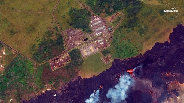 This May 23, 2018, Satellite photo provided by DigitalGlobe shows lava coming out of fissures caused by Kilauea volcano, near Puna Geothermal Venture, a geothermal energy plant, in Pahoa, Hawaii. Wendy Stovall, a scientists with the U.S. Geological Stovall said lava spatter from one of the vents was forming a wall that was helping protect the geothermal plant. (Satellite Image ©2018 DigitalGlobe, a Maxar company via AP)