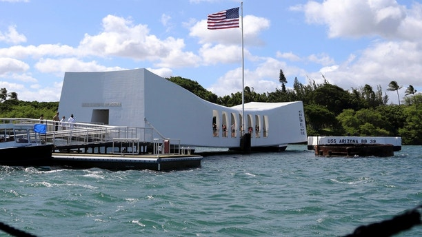FILE - This Thursday, Sept. 21, 2017 file photo shows the USS Arizona Memorial in Pearl Harbor, Hawaii. On Friday, May 25, 2018, officials said damage to the memorial is worse than expected and it will remain closed indefinitely. (AP Photo/Caleb Jones)