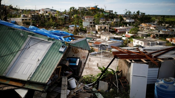 """Houses damaged or destroyed by Hurricane Maria stand at the squatter community of Villa Hugo in Canovanas, Puerto Rico, December 11, 2017. Villa Hugo is a settlement initially formed by people whose houses were damaged or destroyed by Hurricane Hugo in 1989. REUTERS/Carlos Garcia Rawlins  SEARCH """"RAWLINS HUGO"""" FOR THIS STORY. SEARCH """"WIDER IMAGE"""" FOR ALL STORIES. - RC1626CD2200"""