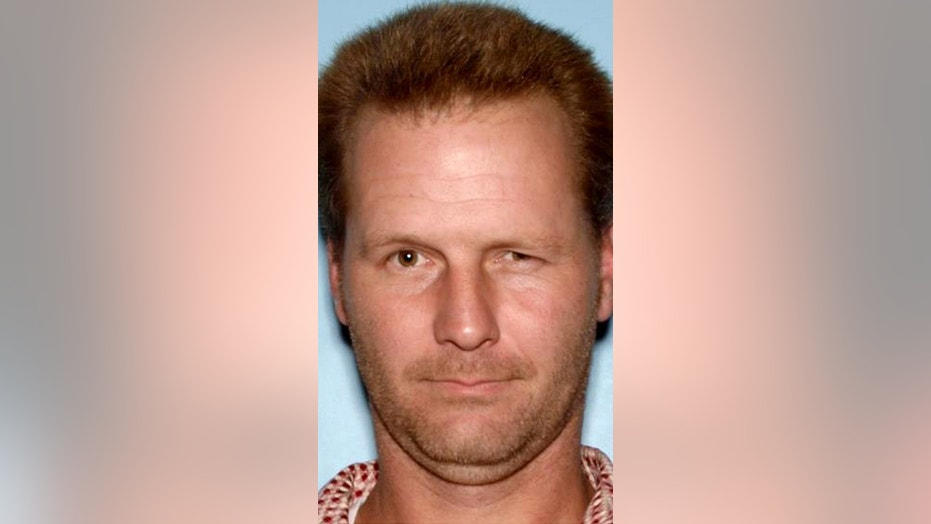 Police are searching for Patrick Nolan, believed to be armed and dangerous, who has been charged with murder in the death of his longtime girlfriend.