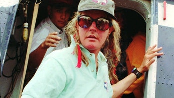 Charlotte Fox, 43, of Aspen, Colo., one of the climbers of Mt. Everest arrives at Katmandu airport on Wednesday, May 15, 1996, after she and another man were evacuated by Nepalese Army helicopters. The team lost it's leader Scott Fischer, 40, of Seattle, Wash., during a deadly storm.  The storm struck Friday on the 29,028-foot-high summit, freezing experienced hikers and newcomers alike with waist-high snow and 70-mph  winds. (AP Photo/Binod Joshi)