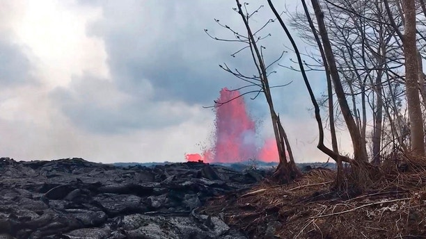 This May 29, 2018 photo from video provided by the U.S. Geological Survey shows lava from a fissure created fountains to heights of 200 feet at times, near Pahoa, Hawaii. (U.S. Geological Survey via AP)