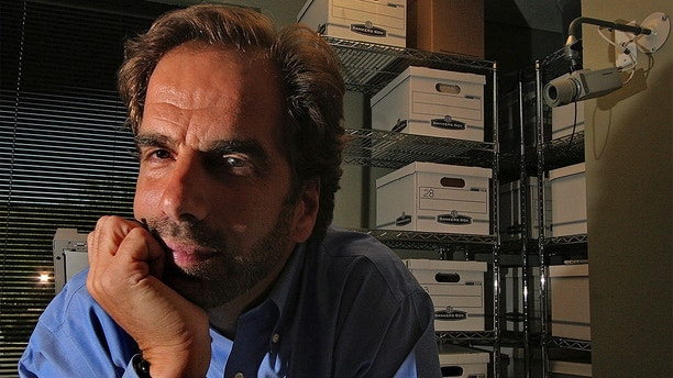 FILE - In this Friday, June 29, 2007, file photo, Dr. Steven Pitt poses in Scottsdale, Ariz. Authorities say the fatal shootings of two paralegals in a Phoenix suburb are related to the killing of Pitt, a well-known forensic psychiatrist in Phoenix, and police are investigating if a fourth homicide is related. (Julio Jimenez/East Valley Tribune via AP, File)