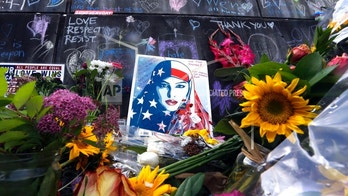 FILE--In this May 31, 2017, file photo, the memorial for two men fatally stabbed on a light rail train is shown in Portland, Ore. Many Portland residents say they love their city's reputation for political dissent but are dismayed it has become a spotlight for violence. (AP Photo/Don Ryan, file)