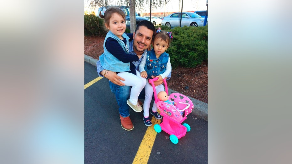 Pablo Villavicencio poses with his two daughters, Luciana, left, and Antonia.