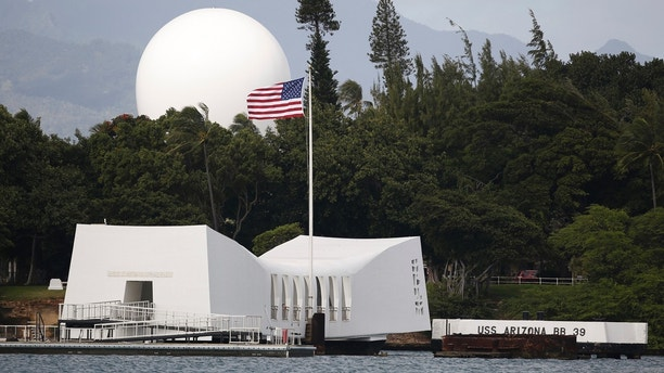 FILE - In this Dec. 27, 2016, file photo, USS Arizona Memorial, part of the World War II Valor in the Pacific National Monument, at Joint Base Pearl Harbor-Hickam, Hawaii. The National Park Service is working as fast as possible to reopen access to the USS Arizona Memorial after cracks were discovered last month on the floating concrete pier near the metal access ramp, officials said. Visitors to the memorial at Pearl Harbor in Honolulu are taken on a 15-minute narrated tour of Battleship Row instead of the usual docking at the site, the Honolulu Star-Advertiser reported Friday, June 8, 2018. (AP Photo/Carolyn Kaster, File)