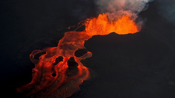 Lava from the Kilauea volcano continues to erupt from a fissure and forms a river of lava flowing down to Kapoho on Sunday, June 10, 2018, in Pahoa, Hawaii. (AP Photo/L.E. Baskow)