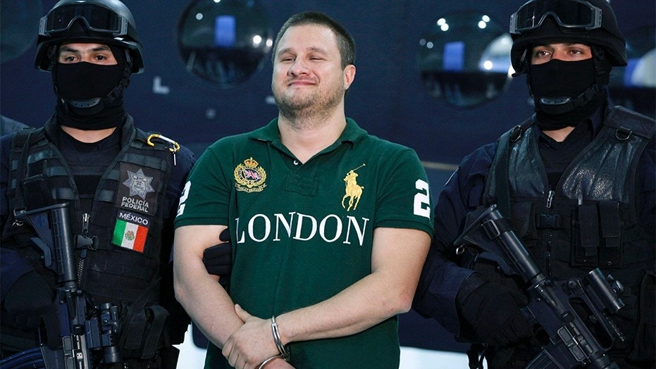 """Aug. 31, 2010: Texas-born Edgar Valdez Villarreal, also known as """"La Barbie,"""" center, reacts during his presentation to the media after his arrest in Mexico City."""