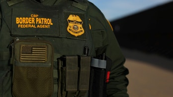 U.S. border patrol agent Alessio Faccin  walks along the border fence separating Mexico from the United States near Calexico, California, U.S. February 8, 2017. Picture taken February 8, 2017. REUTERS/Mike Blake - RC166A17F9D0