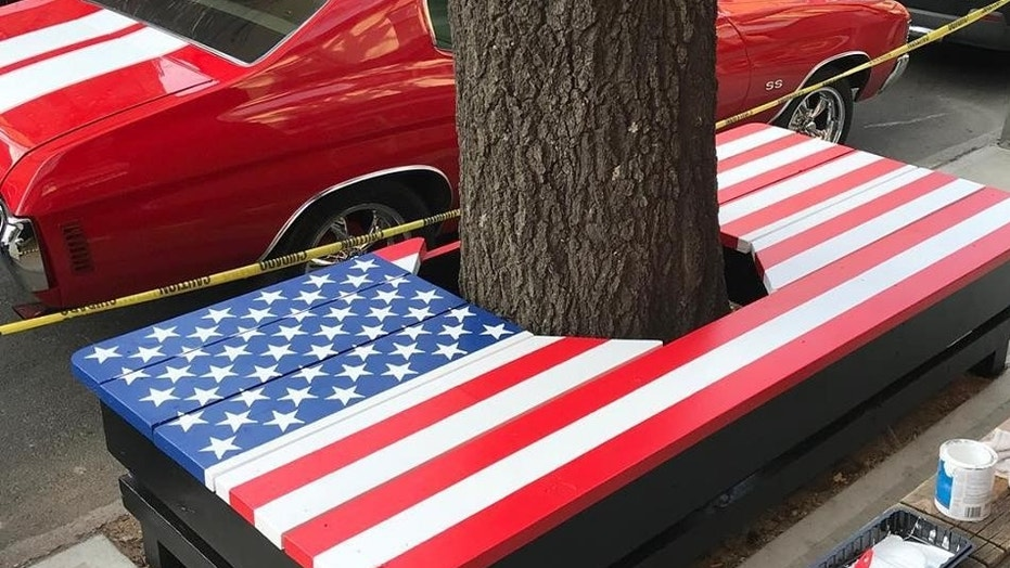 A patriotic bench built around a tree outside of an American Legion post in Brooklyn, New York won't have to be removed after the city initially said it had to after someone filed a complaint.