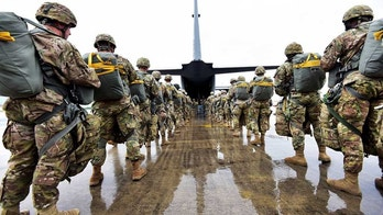 U.S. Army paratroopers assigned to the 173rd Brigade Support Battalion, 173rd Airborne Brigade prepare to board an Air Force C-130 Hercules aircraft assigned to the 86th Airlift Wing at Aviano Air Base in preparation for airborne operation onto Juliet Drop Zone in Pordenone, Italy, May 22, 2018. The 173rd Airborne Brigade is the U.S. Army Contingency Response Force in Europe, capable of projecting ready forces anywhere in the U.S. European, Africa or Central Commands' areas of responsibility. (U.S. Army photo by Davide Dalla Massara)