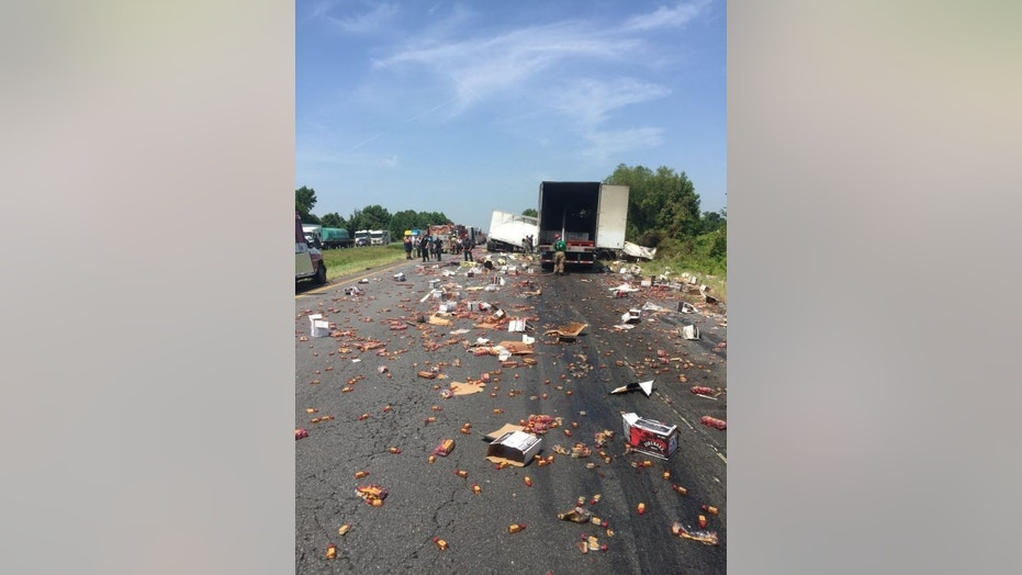 Fireball bottles were splayed across a highway in Arkansas this week as part of a semi-truck crash, KATV reports.