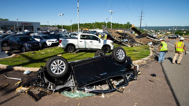 Damaged cars are parked in a debris filled lot on Mundy Street near the Wyoming Valley Mall in Wilkes-Barre Township, Pa., after a powerful storm moved through the area on Wednesday, June 13, 2018. A strong storm has pounded parts of Pennsylvania, damaging buildings, overturning cars and downing trees and power lines. (Christopher Dolan/The Citizens' Voice via AP)