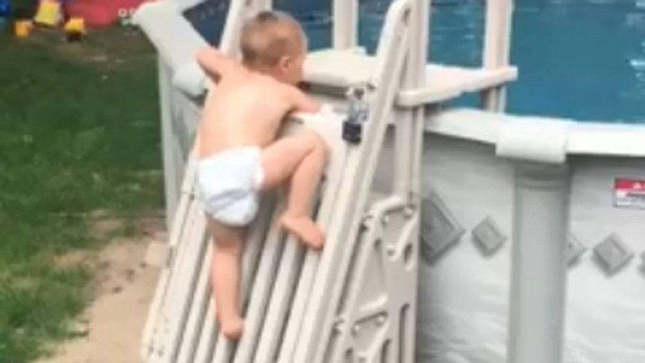A Massachusetts family has captured a viral video Monday of their toddler climbing what is supposed to be a gate stopping children from getting into a pool.