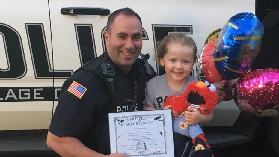 Gabby, 3, gave the police officer an elmo doll so we wouldn't be alone when he was on patrol.