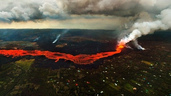 Lava from the Kilauea volcano flows in and around Pahoa, Hawaii, Sunday, June 10, 2018. (AP Photo/L.E. Baskow)