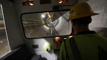 In this Wednesday, May 16, 2018 photo, operator Andrew Reisinger drives a personnel shuttle along a small gauge rail line inside a 2.5-mile bypass tunnel being dug for the Delaware Aqueduct, in Marlboro, N.Y. Hard-hat workers are toiling deep underground, 55 stories beneath the Hudson River, to eliminate gushing leaks in an aging tunnel that carries half the city's water supply over 85 miles from Catskill Mountain reservoirs. (AP Photo/Julie Jacobson)