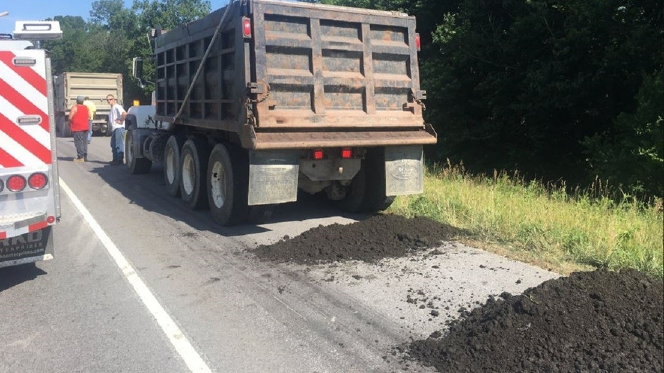 "Indiana State Police say that a dump truck unloaded ""processed human waste"" onto a highway in the Hoosier State on Wednesday."