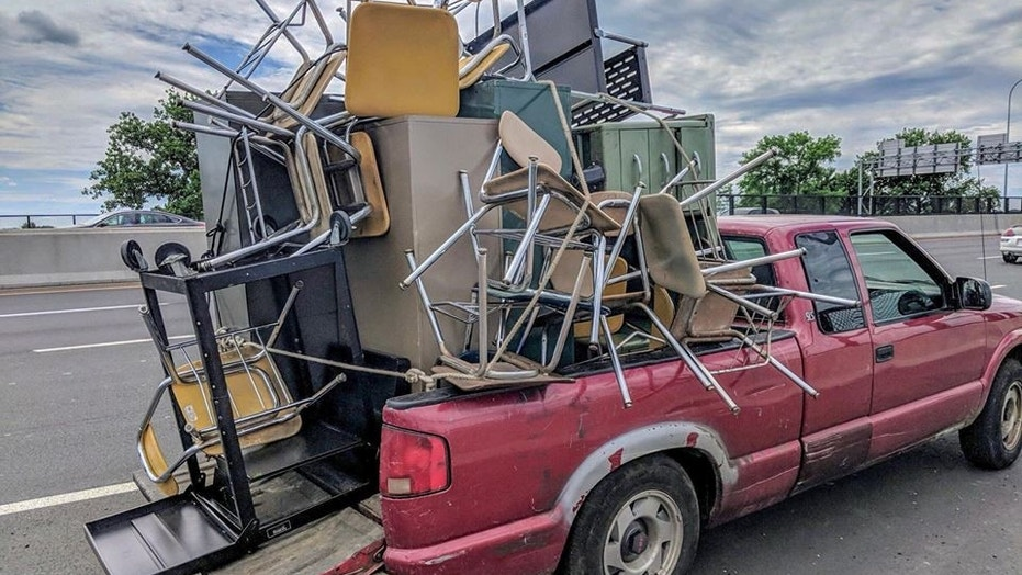 Massachusetts State Police cited a driver in Springfield for an unsecured load on Wednesday.