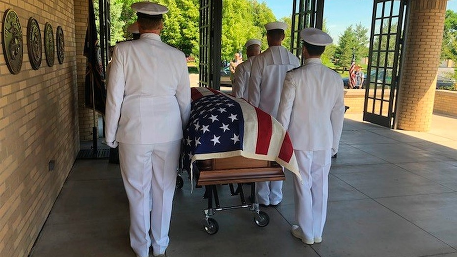 U.S. Navy pallbearers carried the remains of Wallace Eakes, a sailor who was killed in the Japanese attack on Pearl Harbor, who was reburied with full military honors at Fort Logan National Cemetery in Denver, Colo. on Thursday.