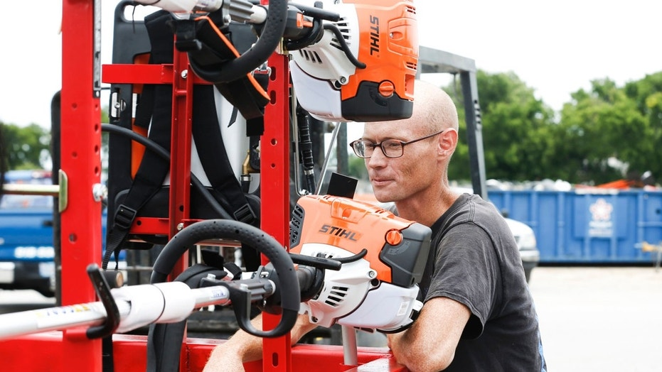 Cody Nichols appraises the new equipment he received from Soldier's Wish at Bloss Equipment in Tulsa, Okla., on Friday, June 22, 2018.