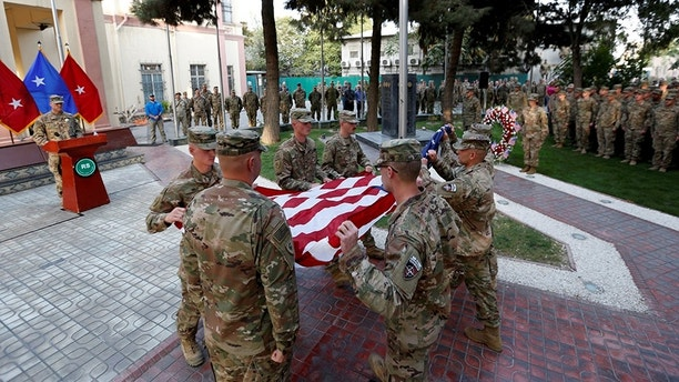 U.S. soldiers prepare to raise the American flag during a memorial ceremony to commemorate the 16th anniversary of the 9/11 attacks, in Kabul, Afghanistan September 11, 2017. REUTERS/Mohammad Ismail - RC17AC996770