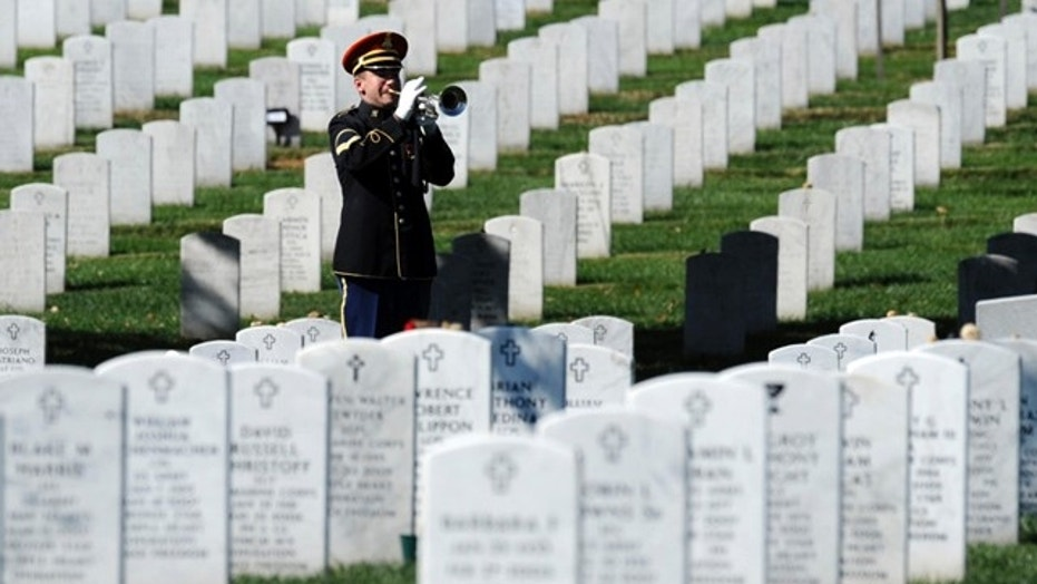 A bugler playing 'Taps' during the 2009 funeral for Army Spc. Stephen Mace at Arlington Cemetery in Arlington, Va.