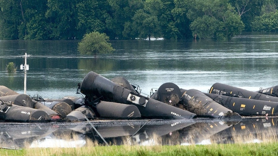 Tank cars carrying crude oil are shown derailed in Lyon County, Iowa, Friday.