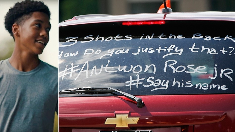 Mourners wrote messages on the back of their vehicles Monday for Antwon Rose's funeral.