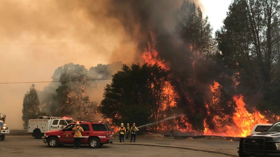 Firefighters battle the  wildfire in an area northeast of Clearlake Oaks, Calif.